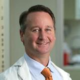 Dr. Damon Raskin